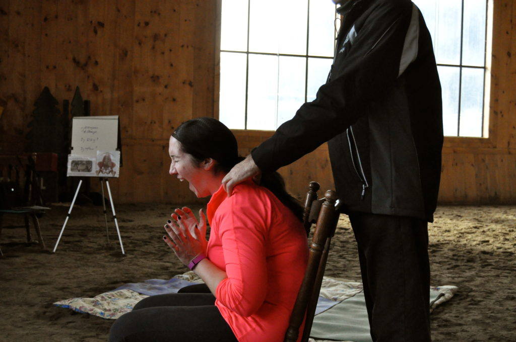 Hans helping Aimee to release tension in her shoulders - OUCH!