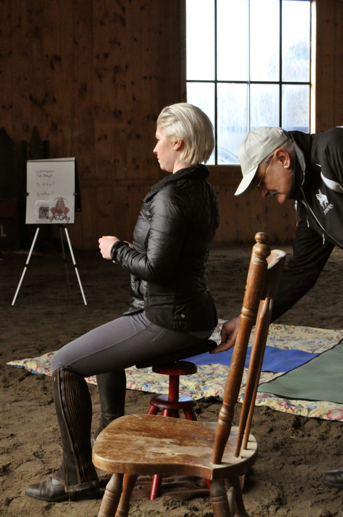 Whitney using the Balimo Chair to practice moving her hips from 12-6 (forward and back).